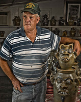 portrait of Jerry Brown of Hamilton, Alabama. He is a ninth generation potter. He makes primarily utilitarian forms such as jugs, churns, and bowls, as well as face jugs and other figural forms.
