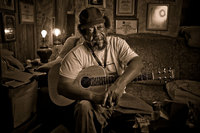 portrait of Willie King, blues musician from Old Memphis in Pickens County Alabama. First guitar was improvised by fastening bailing wire to a broom handle. He was the subject of a Dutch documentary film Down in the Woods